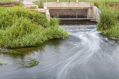 Cleaned sewage flowing Royalty Free Stock Photo