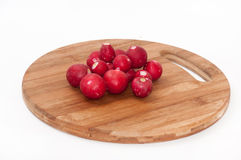 Cleaned and washed radishes on the wooden kitchen board Stock Images