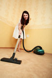 Cleaner. Beautiful girl in a interior Stock Photography