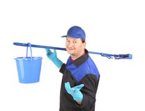 Cleaner with basket and mop. Royalty Free Stock Photos