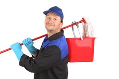 Cleaner with basket and mop. Royalty Free Stock Photo