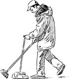 Cleaner on a city street Royalty Free Stock Images