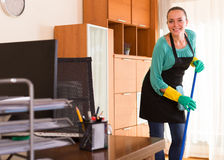 Cleaner  cleaning in the office-room Royalty Free Stock Photos