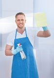Cleaner cleaning a pane of glass Stock Photos