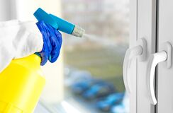 Free Cleaner Disinfecting Window Handles Royalty Free Stock Image - 179152536