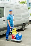 Cleaner In Front Of Van With Cleaning Equipments Stock Image