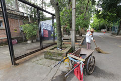 The cleaner and his trolley in redtory creative garden, guangzhou, china royalty free stock photo