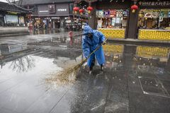 Free Cleaner In The Rain Stock Photos - 126278403