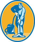 Cleaner Janitor Worker Vacuum Cleaning. Illustration of a janitor cleaner worker vacuum cleaning facing front set inside ellispe done in retro style Royalty Free Stock Photo