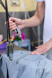 Cleaner laundry on steam cleaner Stock Photo