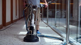 Cleaner Male Worker Cleaning Hotel Corridor Carpet