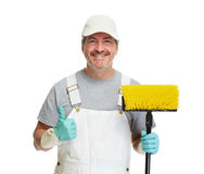 Cleaner man with broom. Isolated on white background Stock Images