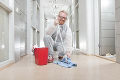 Cleaner. Man in Overall Cleaning Office Corridor royalty free stock photos
