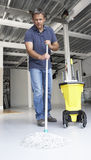 Cleaner mopping office floor Stock Photo
