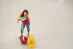 Cleaner mopping office warehouse floor Stock Photo
