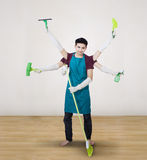 Cleaner with multi hands at home Stock Photo