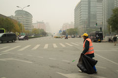 A cleaner in polluted air Stock Image