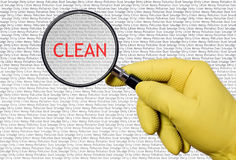 Cleaner is searching with magnifying glass Royalty Free Stock Images