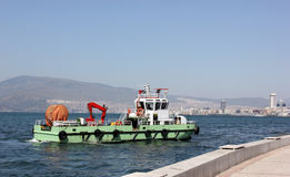 Cleaner ship cleaning water (Izmir bay) Stock Images