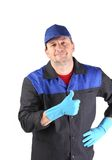 Cleaner showing thumbs up. Royalty Free Stock Photography