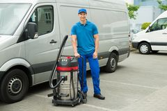Cleaner Standing With Vacuum Cleaner Stock Images