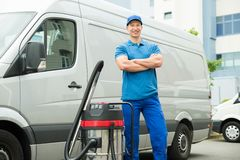 Cleaner Standing With Vacuum Cleaner Royalty Free Stock Photo