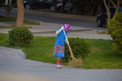 The cleaner of streets behind work Stock Images