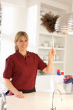 Cleaner Working In Domestic Kitchen Royalty Free Stock Images