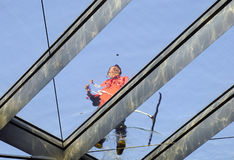 Cleaner working on the skylight Royalty Free Stock Image