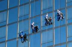Cleaners on the building 2 Stock Photos