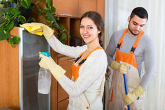 Cleaners cleaning in room Royalty Free Stock Photo