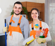 Cleaners cleaning in room Stock Images