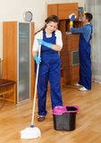 Cleaners cleaning in room Royalty Free Stock Photos