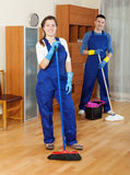 Cleaners  cleaning in room Royalty Free Stock Images