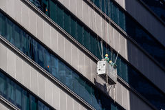 High-Rise Window Cleaners in Singapore. Cleaners cleaning the windows of a skyscraper in Singapore Stock Image