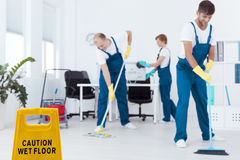 Cleaners mopping floor Royalty Free Stock Image