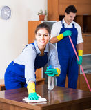 Cleaners in overalls with supplies Royalty Free Stock Images
