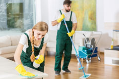 Cleaners putting in order dirty apartment Stock Image