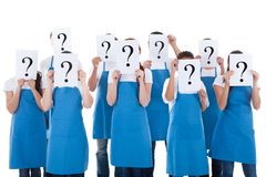 Cleaners showing question sign. Group of cleaners showing question sign above faces. Isolated on white stock photography