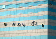 Cleaners on the skyscraper Royalty Free Stock Photo