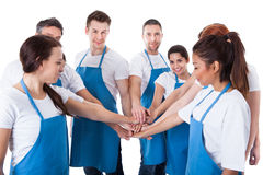 Cleaners stacking hands Stock Photo