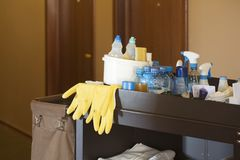 Cleaners Trolley In A Hotel. Cleaners trolley with cleaning equipment in a hotel Stock Images