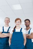 Cleaners wearing blue uniforms Stock Image