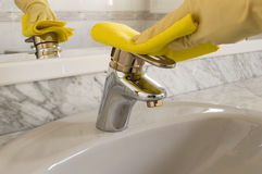 Cleanig a faucet Stock Photos