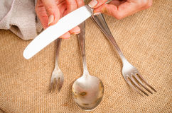 Cleanign silverware Obrazy Royalty Free