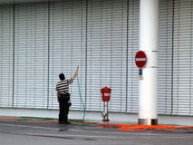 Cleaning 003. A cleaner at his job. June 06 Stock Image