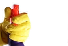 Cleaning. Gloved hand with a purple spray isolated over white background Royalty Free Stock Photo