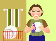 Cleaning. A lovely mother is cleaning a bowl Royalty Free Stock Photos