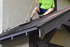 Free Cleaning A Roof Of Residue Royalty Free Stock Photography - 151735267