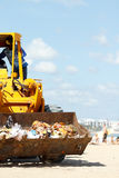 Cleaning of accumulation garbage on  the beach Stock Images